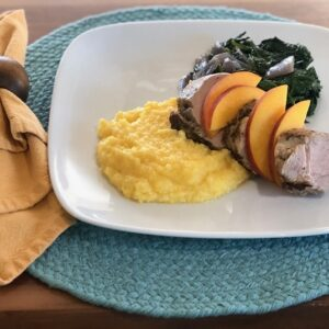 Pork with Peaches polenta spinach onions